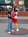 Fredbird and a fan, out in center field.