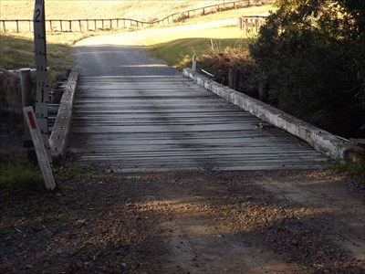 A wooden Plank Bridge, probably about 20 m long, on Kennedys Gap Road, Coolongolook, NSW.1600, Friday, 12 August, 2016