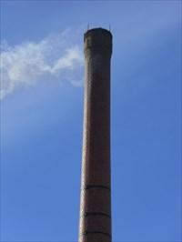 Photo gros plan de la cheminée qui fait parti de l