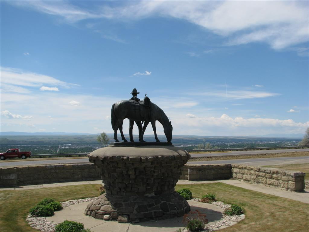 The statue features a cowboy
