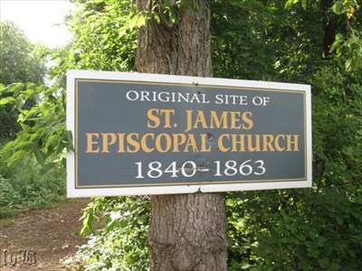 Sign along the road indicates the path to the original site of the St. James Episcopal Church.
