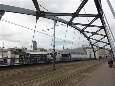 The twin tram tracks and pedestrian walkway can be seen