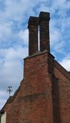 ...twin stack on the external flue, west end.