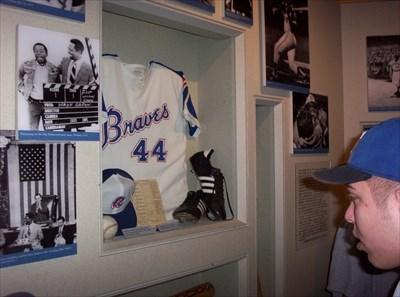 My son looks at the Hank Aaron display.