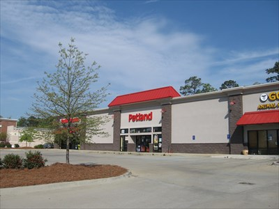 View of the parking lot and next door store.