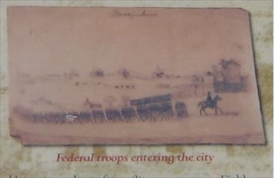 tintype of troops entering the city