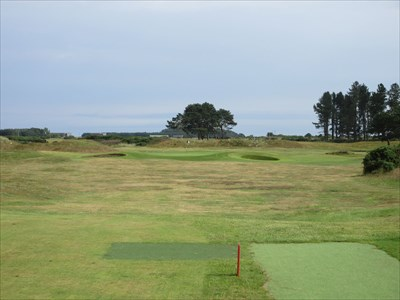 The sixteenth is a par three over typical seaside links.