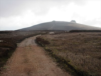 View from the Hill of Edendocher path. The pillar lies between the two tors on the horizon.