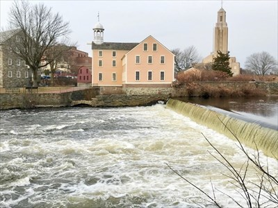 Slater Mill as seen from across the falls of the Blackstone River.