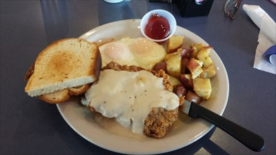 Chicken Fried Steak and eggs for breakfast, with rosemary potatoes and toast.
