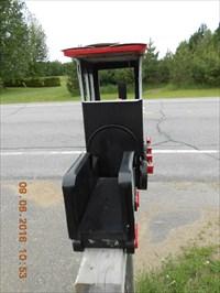 Photo avec vue arrière du wagon a charbon.  Photo with rear view of a coal wagon.