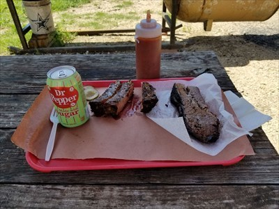 Sliced brisket and pork ribs.  You really don't need that sauce, although it's nice sauce.  The pickles and pickled onions (hidden) are homemade, and amazing.