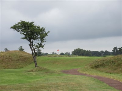 The short third hole is only 100 yards long to a green set on top of a dune.