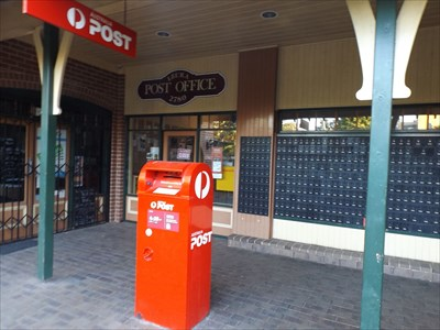 A view of the entry to the Post Office, with the Postal Boxes to the side.