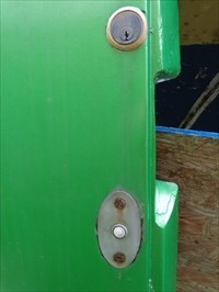The lock, and what I've found is actually a doorbell, not a button to open the hatch.