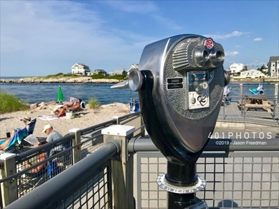 These coin-operated binoculars overlook Point Judith Harbor.