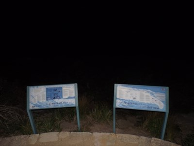 Some information signs on the northern side of the headland.