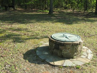 Union and Confederate troops had a hell of a time fighting in the woods to the south of this compass rose.