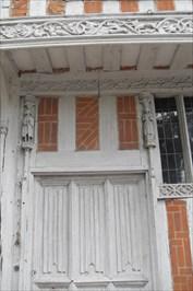 ...linen-fold carving on front elevation.