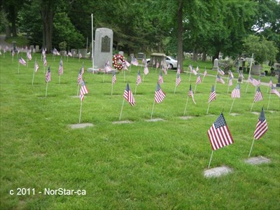 It was Memorial Day weekend; the graves were decorated with flags and wreaths.
