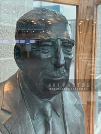 A bronze bust of Theodore Francis Green is displayed in a glass case on an oak plinth near the center of the main lobby of the eponymous T.F. Green Airport in Warwick, Rhode Island. Green was the Governor (1933-7) and a US Senator (1937-61).