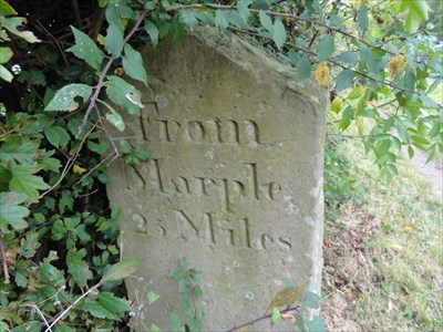Th carving is very worn on this milestone but looks like 26 miles. However it
