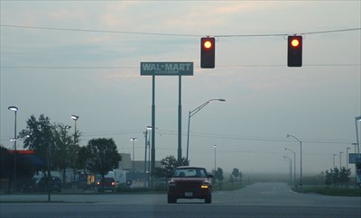 Photo taken approx. 7:00 am. Sept 11, 2009, looking east down David Drive from Highway 81 / S. Lincoln Ave.  SuperCenter sign  and WalMart visible in the background.