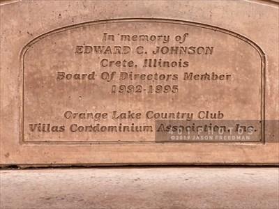 Dedication text reads: <br><br> In memory of <br> EDWARD C. JOHNSON <br> Crete, Illinois <br> Board of Directors Member <br> 1992 - 1995 <br> <br>  Orange Lake Country Club <br> Villas Condominium Association, Inc.