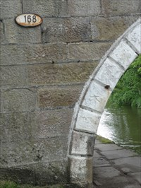 The metal bolt that used to hold the wooden post to protect the bridge from tow ropes is still visible.