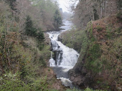 Seen from the pathway along the northern bank. This is the best view of the entire waterfall. The River Isla and Bridge of Craigisla are in the distance.