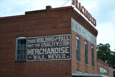 This building may fall but the quality of our merchandise never will.