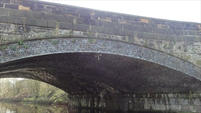 The join in the bridge can be seen where the original stone arch meets the new brick arch.