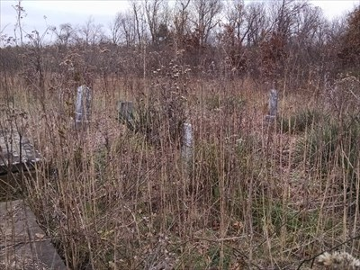 Deal Cemetery - Abandoned, by MountainWoods.  To the left are two tombs.  Ahead are 4 of the at least 6 free standing grave markers.