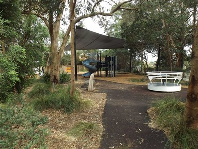 The entry path to the Playground. Showing the 'Hirdy-Girdy'/Spinner, and other elements of the Playground.0902, Saturday, 2 December, 2017
