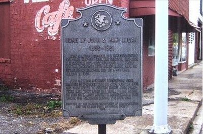 House was where empty lot is now, to the right of marker.
