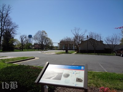 The Historic District marker faces down Courthouse Rd. The colonnaded building at the intersection was a tavern that survived the Battle of Spotsylvania Court House and today houses law offices.