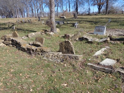 Alpha Lewis is at the right.  Odd place for a more contemporary burial, among older fieldstones and one modern headstone that marks and infant burial from 1896.