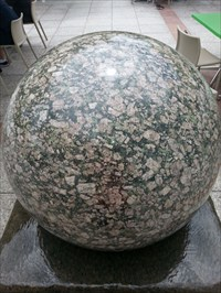 This photo taken from outside Questacon at a Granite Sphere located at the same building