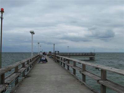 Anglers relaxing and fishing along the pier