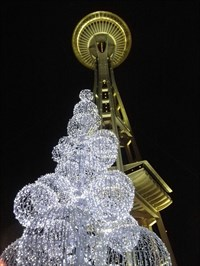 This picture was taken at night and includes a cool sculpture below the space needle!