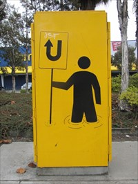 Man with U-Turn Sign, Emeryville, CA