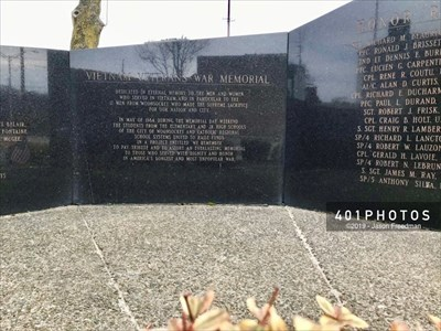 """The third panel from the left reads: VIETNAM VETERANS' WAR MEMORIAL --- DEDICATED IN ETERNAL MEMORY TO THE MEN AND WOMEN WHO SERVED IN VIETNAM, AND IN PARTICULAR TO THE 17 MEN FROM WOONSOCKET WHO MADE THE SUPREME SACRIFICE FOR OUR NATION AND CITY. -- IN MAY OF 1984, DURING THE MEMORIAL DAY WEEKEND THE STUDENTS FROM THE ELEMENTARY AND JR. HIGH SCHOOLS OF THE CITY OF WOONSOCKET AND CATHOLIC REGIONAL SCHOOL SYSTEMS UNITED TO RAISE FUNDS IN A PROJECT ENTITLED """"WE REMEMBER"""" TO PAY TRIBUTE AND ASSURE AN EVERLASTING MEMORIAL TO THOSE WHO SERVED WITH DIGNITY AND HONOR IN AMERICA'S LONGEST AND MOST UNPOPULAR WAR."""