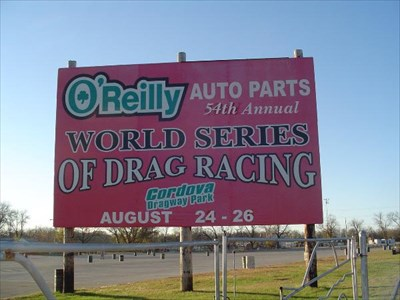 A sign beside the road of the drag park.