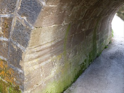 Grooves made by the ropes that were used by horses to pull the barges along the canal.