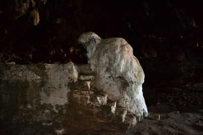 The cave is called the Cave of Panagia Arkoudiotissa (Our Lady of the Bear), or Arkoudospilios (Bear Cave) in Greek. It got its name from a big stalagmite in it that looks like a crouching bear. (GC-code: GC3WHDH)