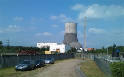 View to the reactor (building right) and power house (left). The cooling tower is in the background. This photograph has been taken from the west side of the areal.