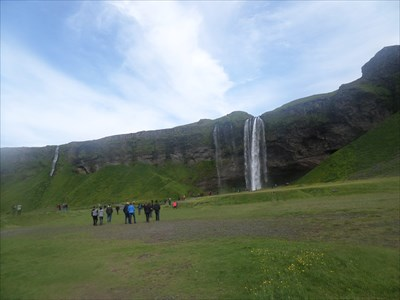 Photo of both Seljalandsfoss on the right and the smaller Fosstunsfoss on the left.