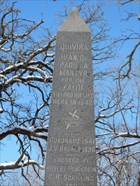 Top portion of the obelisk of the side with text.