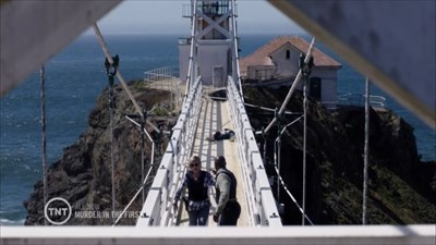 Hildy and Terry on Suspension Bridge to the Lighthouse, the dead suspect behind them on the bridge, Marin Headlands, California