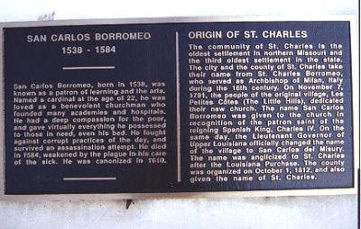 This plaque is on the statue base, includes the Origin of St. Charles as well as San Carlos Borromeo.